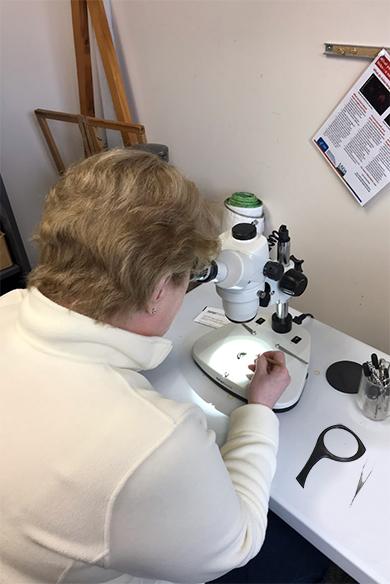 Person using a microscope.